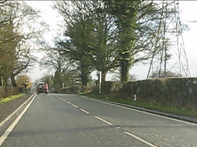 Power lines cross the A537 east of Henbury