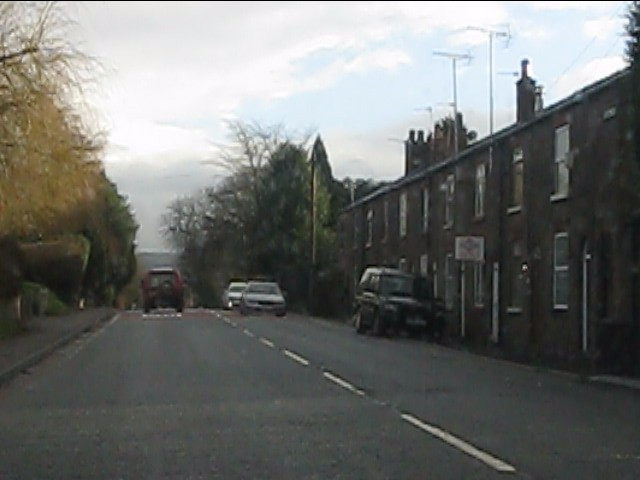Terraced houses alongside the A537