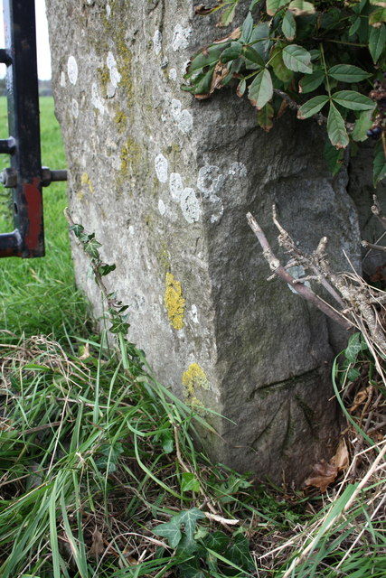 Benchmark on gatepost beside A684