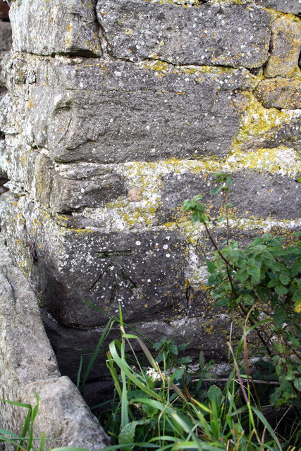 Benchmark on small barn on east side of Gale Bank