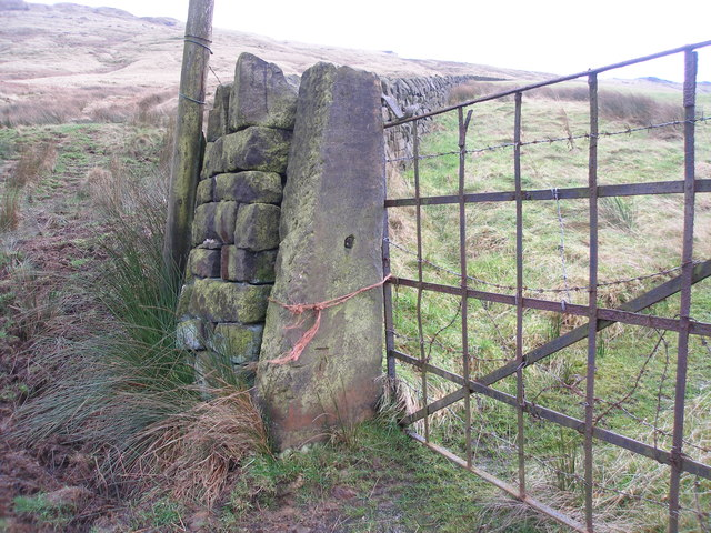 Cut benchmark on a gatepost near Broad Carr Farm