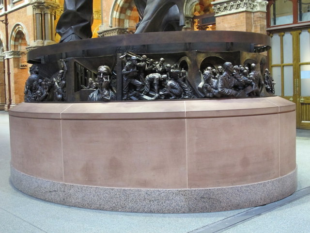 """The base of  """"The Meeting Place"""", St. Pancras Station"""