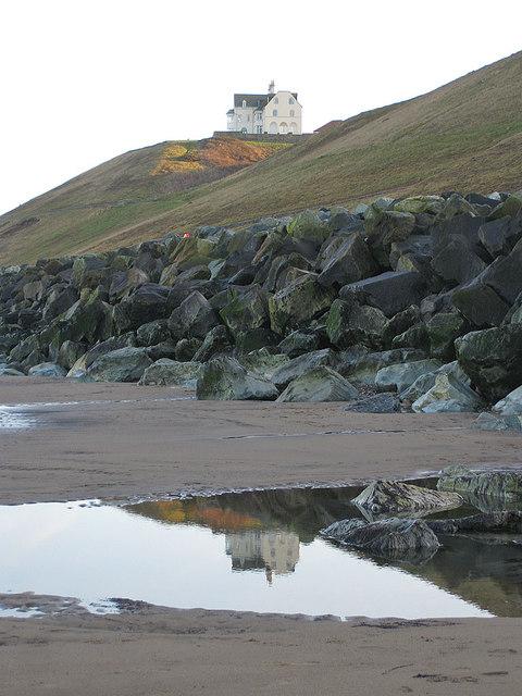 Rockpool reflection and sea defences