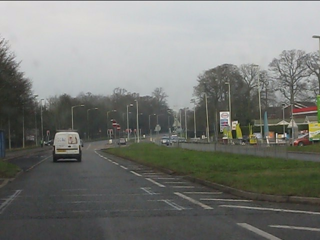 A41 approaching the traffic light crossroads at RAF Cosford
