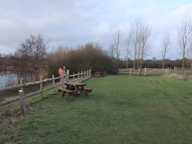 Picnic benches next to Langdon Lake
