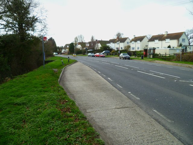 Bus stop opposite footpath on the B2145 at Hunston