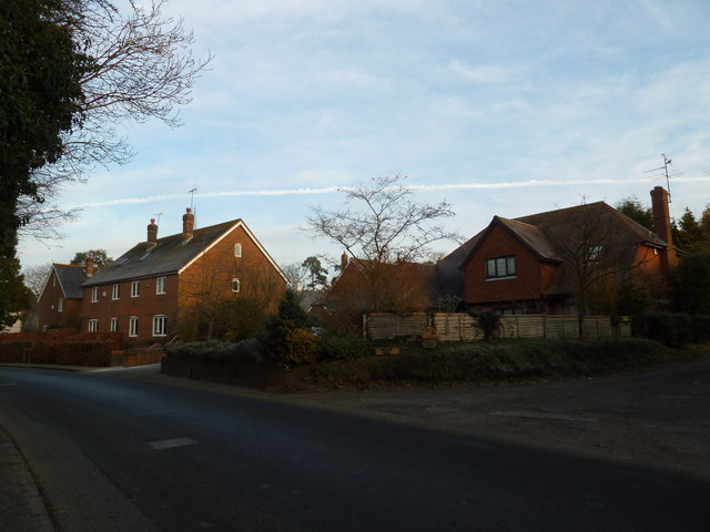 Vapour trail above the B3006 at Selborne