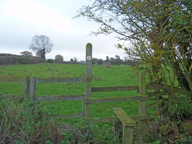 Stile, well and garage