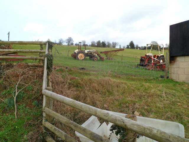 Old tractors in a field at the edge of Welsh Newton