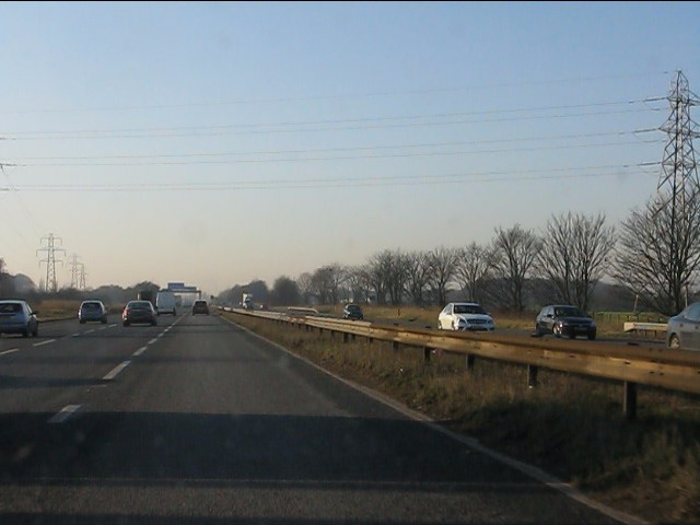 Power lines cross the westbound M62