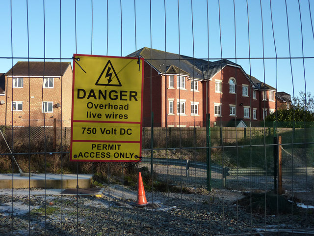 Warning notice on Metrolink line fencing