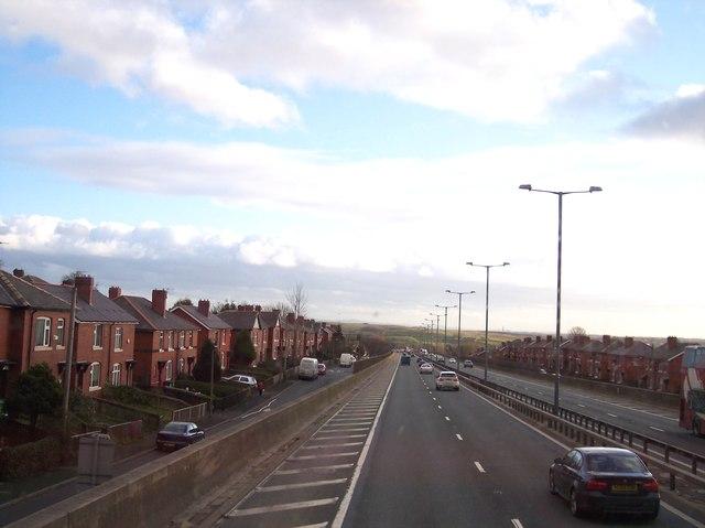 M66 passing through housing estate near Bury