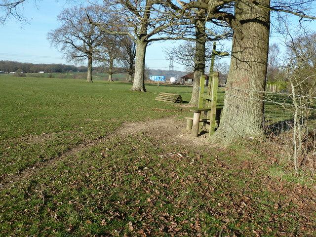 Stile and waymarker near Teagues Farm