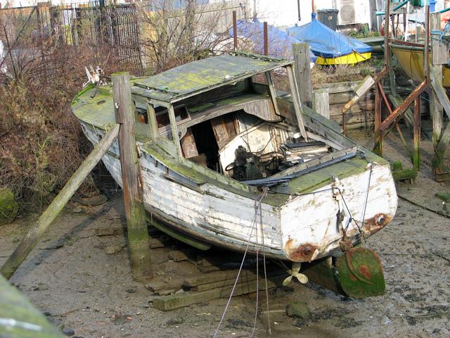 Dilapidated old boat in Belstead Brook, Ipswich