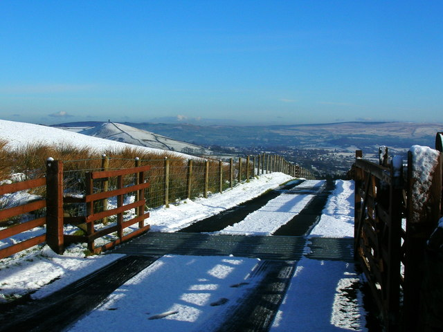 Cattle grid and snowy access road