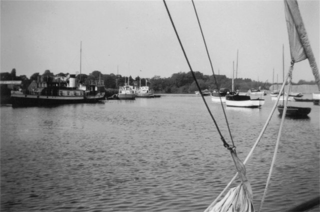 Boats and a steam vessel on river
