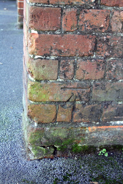 Benchmark on buttress of #8 Reading Road