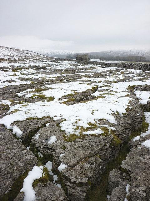 Snow covered limestone pavement near Rigg Barn