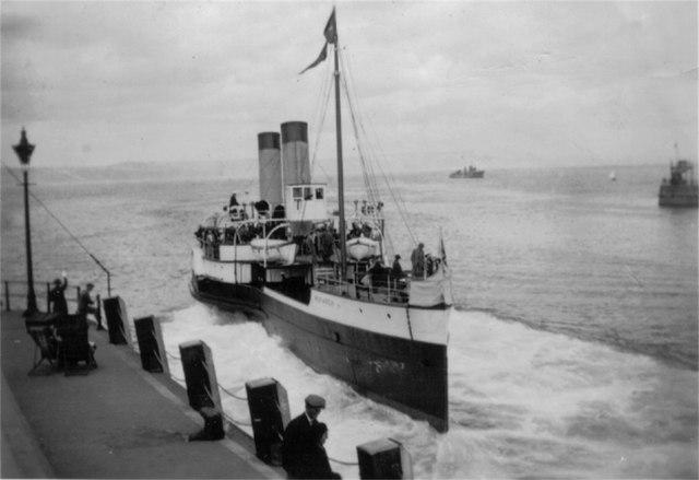 """Paddle steamer """"reversing"""" away from pier"""