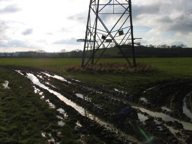 Muddy field entrance and pylon base