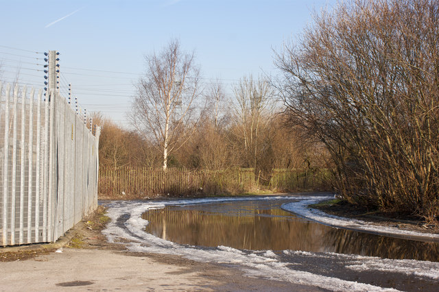 A frozen road and fences