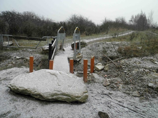 Is a rock, concrete filled pipes, a ditch, squeeze gate and a narrow bridge enough to deter off roaders?