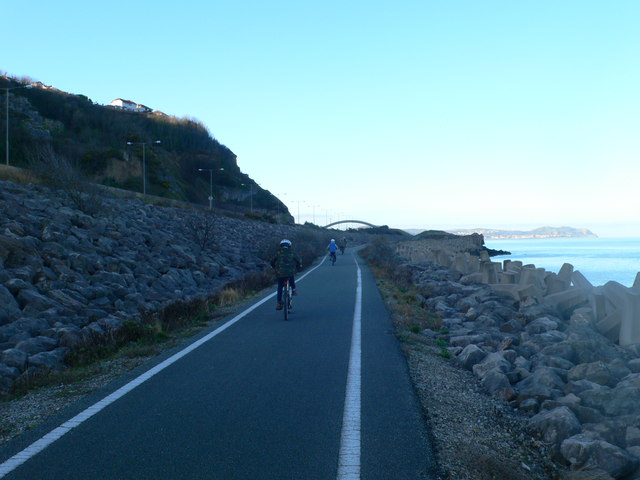 Cyclists on the Coastal Path west of Llanddulas Jetty
