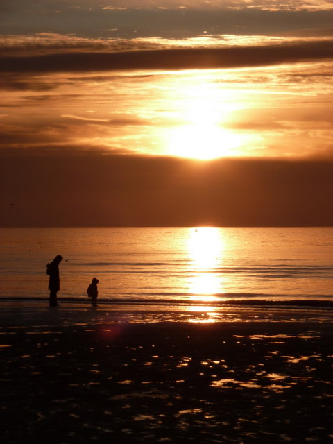 Blackpool: mother and child on the beach at sunset
