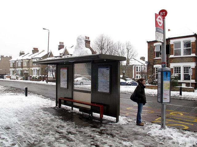 Snowman waiting for a bus
