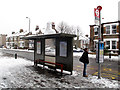 TQ4077 : Snowman waiting for a bus by Stephen Craven
