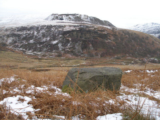 Rock with cut benchmark by the Pennine Way