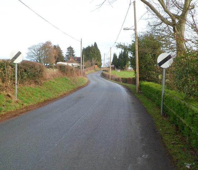 End of 30mph speed limit on Sluvad Road near New Inn