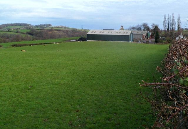 Field and farm buildings on the north side of Sluvad Road near New Inn