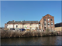 SO8554 : Back of builders' yard, on the canal by Peter Barr