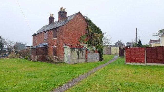 Boarded-up cottages