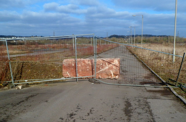 Slab of rock and fencing blocks road at the western edge of Glan Llyn