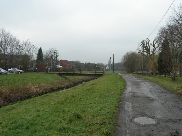 Unmade road by Poulton Park Golf Club
