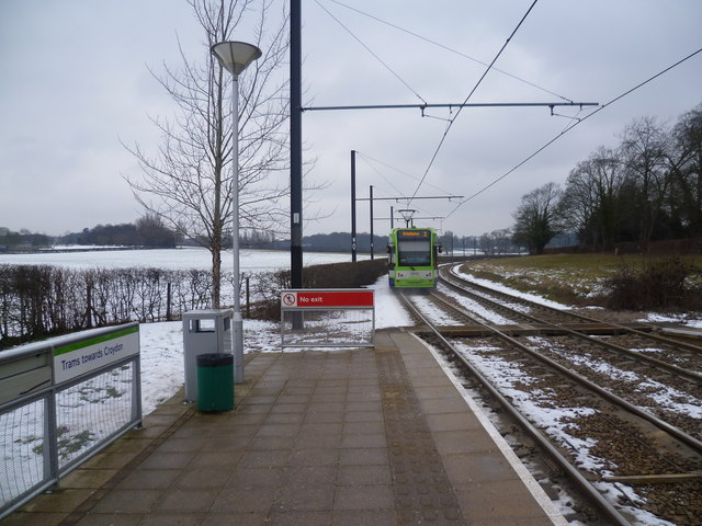 Tram heads away from Gravel Hill in the snow