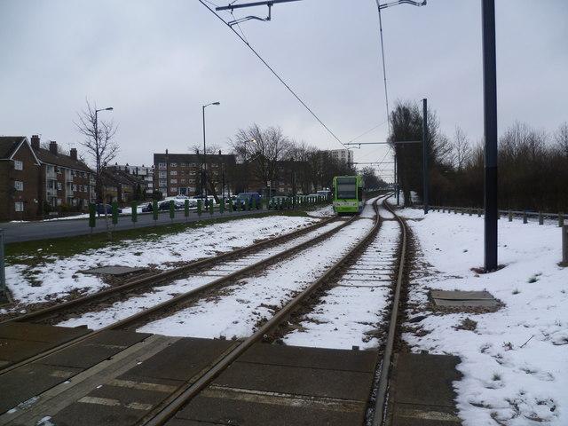 A tram heads away from Fieldway towards New Addington