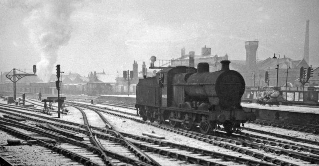 LMS Fowler 4F 0-6-0 passing Manchester Exchange