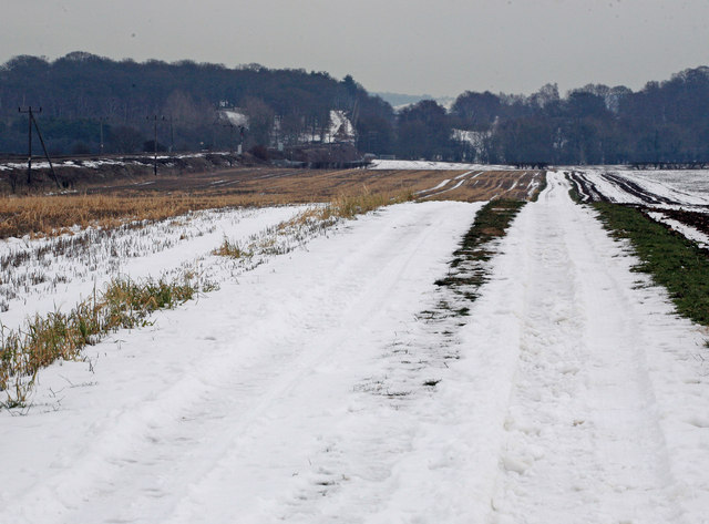 Snow on the field and path