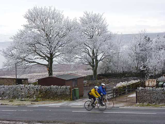 Cyclists passing Weather Hill