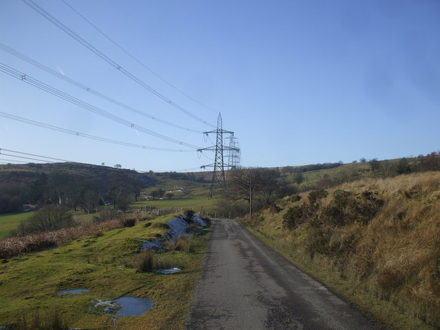Approaching the cattle grid between Penllan Fach Farm and Hafod Farm