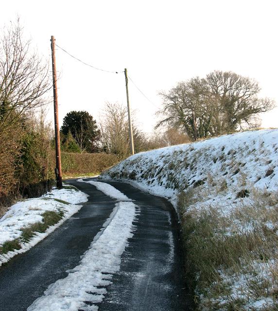 Snowy country lane linking Hintlesham and Chattisham