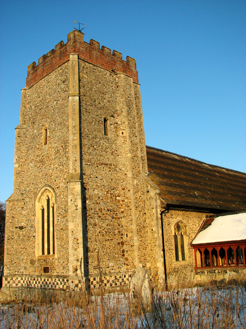 The tower of Washbrook St Mary's church in evening sunshine