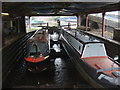 SJ3966 : Two narrowboats in a graving dock by Richard Hoare