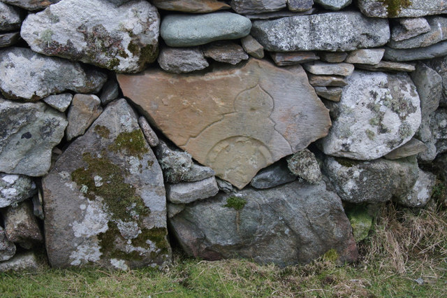 Carved stone in dry stone dyke at Framgord