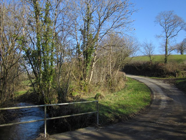 Stream and lane near Upcott Mill