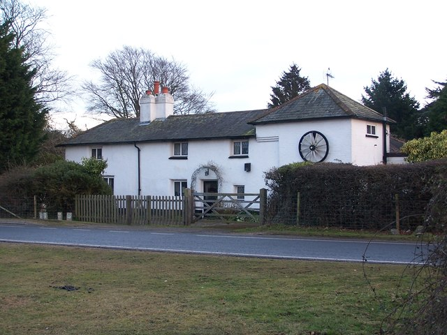Cottage with cartwheel