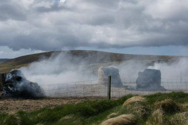 Burning old bales, Norwick